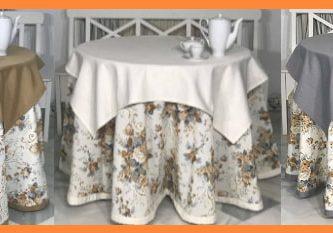mesas camilla con bonitas enaguas en salón de casa